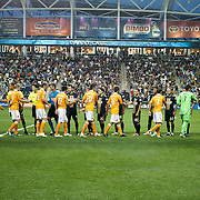 The Philadelphia Union and The Houston Dynamo players shake hand with each other on the field after the singing of national anthem. The Dynamo and The Philadelphia Union played to a 1-1 tie. Saturday Aug. 6, 2011. at PPL Park in Chester PA...The News Journal/SAQUAN STIMPSON