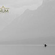 lake mcdonald lone kayaker on calm lake glacier national park