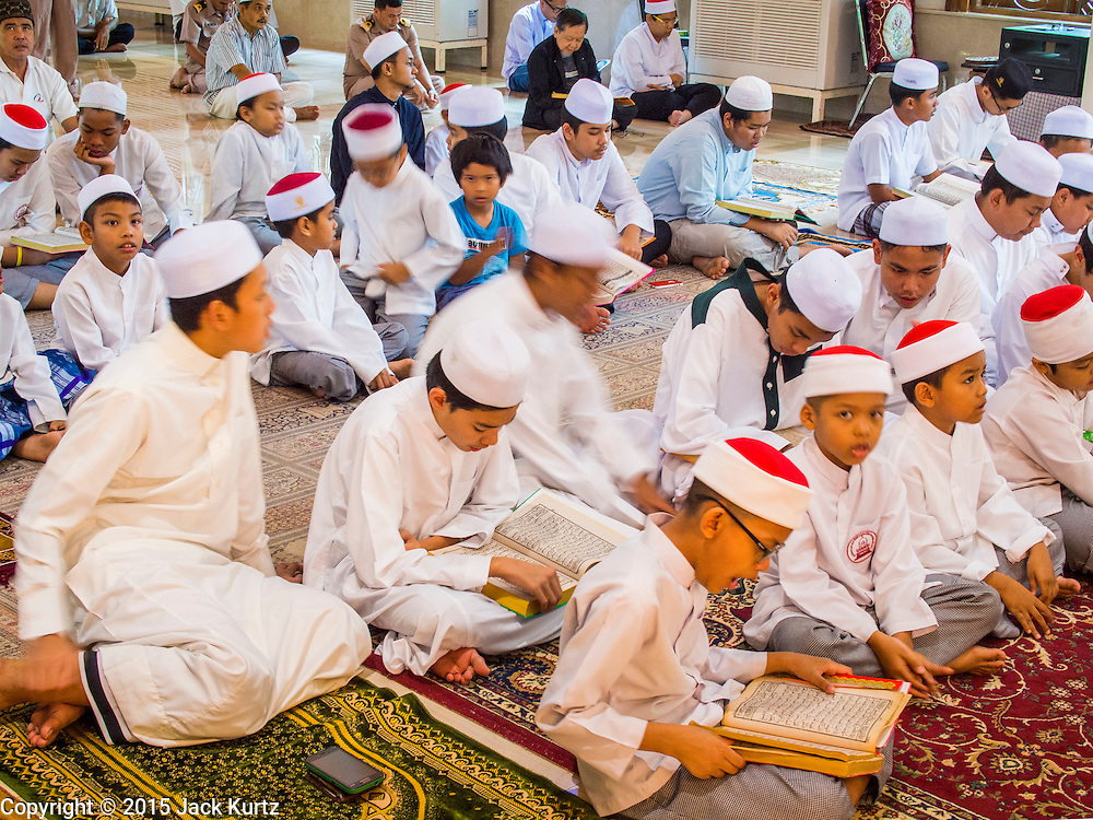 10 APRIL 2015 - BANGKOK, THAILAND: Thai teenagers at Friday prayers in Masjid Ton Son in Bangkok. (Masjid is the Thai word for Mosque.) A Pew Research Center study recently released identified Islam as the fastest growing religion in the world. Masjid Ton Son was the first mosque in Bangkok, founded in 1688 during the reign of King Narai, of the Ayutthaya era. Muslims are about 5 percent of Thailand, but make up a bigger proportion of Bangkok. Thailand's deep south provinces are Muslim majority.    PHOTO BY JACK KURTZ