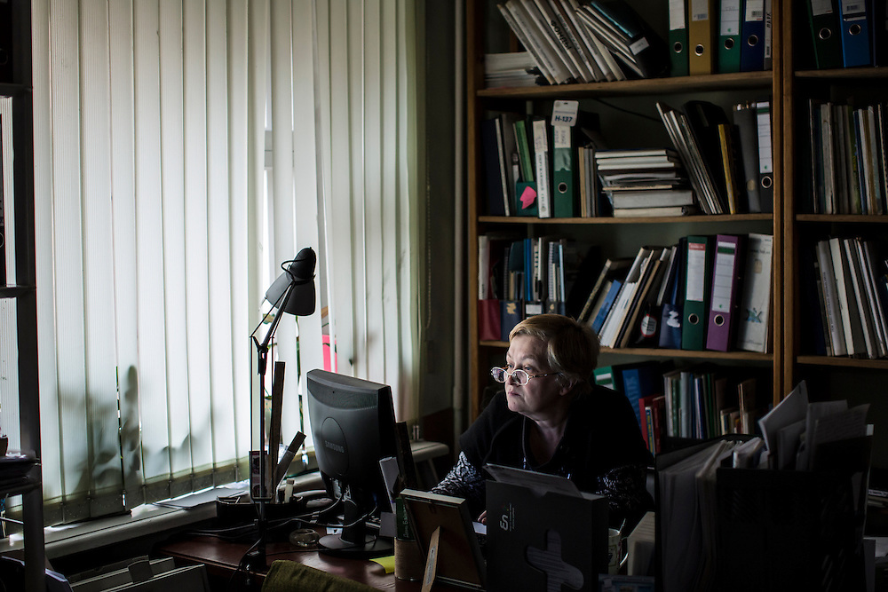 Marina Rikhvanova of Baikal Environmental Wave, an organization that has been lobbying for the closure of the Baikalsk Pulp and Paper Mill for decades, works at her desk in the group's office on Tuesday, October 29, 2013 in Irkutsk, Russia.