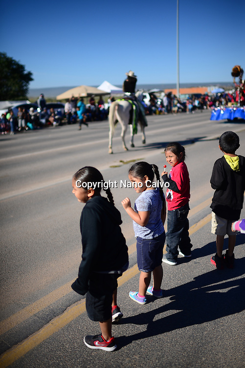 Kids wait and catch candies during morning parade at Navajo Nation Fair, a world-renowned event that showcases Navajo Agriculture, Fine Arts and Crafts, with the promotion and preservation of the Navajo heritage by providing cultural entertainment. Window Rock, Arizona.