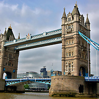 Tower Bridge in London, England<br /> The Romans were the first to construct a bridge crossing the River Thames during the 1st century. Two former spans were called the London Bridge. The medieval version was constructed in 1209. The second was finished in 1831. When it came time for a replacement, it was sold to Robert McCulloch in 1968 and reassembled in Arizona. The iconic Tower Bridge was constructed downstream in 1894. The length is 801 feet and the twin towers are 213 feet tall. Two center bascules can be raised in five minutes to allow the passage of tall ships. In the elevated walkway and beneath the facade of Portland stone and Cornish granite are 11,000 tons of steel.