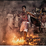 Devotees of the Chinese Shrine of Gim Tsu Ong, near Phuket, Thailand, walk on hot coals as others look on during ceremonies at the Vegetarian Festival.
