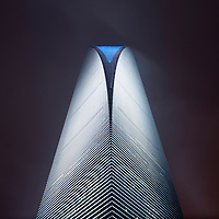 China, Shanghai, Low-angle view from base of Shanghai World Financial Center on foggy night in Pudong District