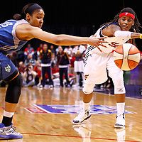 INDIANAPOLIS, IN - OCTOBER 21: Shavonte Zellous #1 of the Indiana Fever passes the ball off as Maya Moore #23 of the Minnesota Lynx defends during Game Four of the 2012 WNBA Finals on October 21, 2012 at Bankers Life Fieldhouse in Indianapolis, Indiana. NOTE TO USER: User expressly acknowledges and agrees that, by downloading and or using this Photograph, user is consenting to the terms and conditions of the Getty Images License Agreement. (Photo by Michael Hickey/Getty Images) *** Local Caption *** Shavonte Zellous; Maya Moore