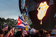 HAVANA, CUBA - MARCH 25, 2016: The iconic tongue and lip logo of The Rolling Stones lights up as fans eagerly wait for a free performance by The Rolling Stones at Ciudad Deportiva on March 25, 2016 in Havana, Cuba. The Rolling Stones performance is the first by a major international rock band in Cuba, coming days after a historic visit by President Barack Obama of the United States, and a game between the Tampa Bay Rays and the Cuban National Team at Estadio Latinoamericano. The Cuban government banned rock music on Cuban state TV and radio following the Cuban the revolution, and nearly a half-million people are in attendance to be part of the historic event. (Photo by Jean Fruth)