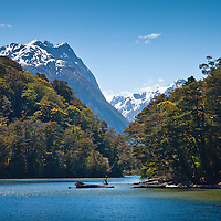 Mountainous backdrop to the Glade Wharf approach from Lake Te Anau, marking the beginning of the Milford Track, Fiordland, New Zealand