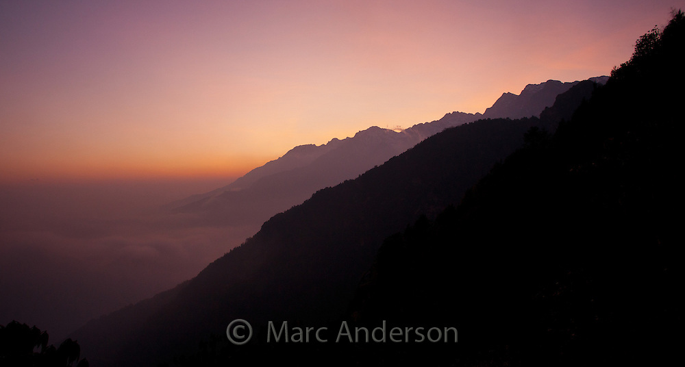 Silhouette of mountains at sunset against a lilac sky, near Ghopte, Langtang National Park, Nepal