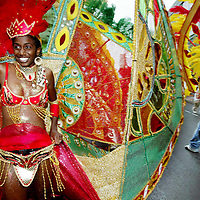 Performers dance in the Cambridge Carnival Parade, Sunday, August 27, 2003.