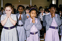 Prayers at assembly in London primary school