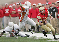 Jodi Miller Lubbock Avalanche-Journal..Coronado quarterback Austin Zouzalik (16) managed to elude Bowie defenders Marcus McGraw (36) and Jimmy Ekumah (29) and stay in bounds on a scramble in the 3rd quarter. The run set up a Landon Quigley touchdown on the next play.