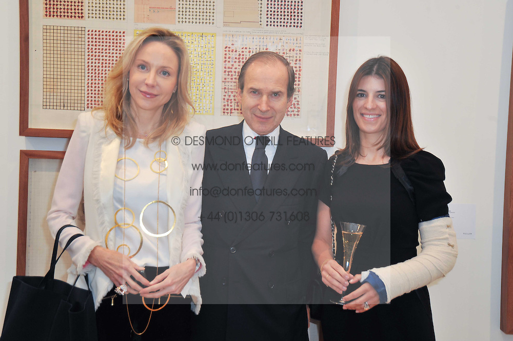 Left to right, MICHAELA NEUMEISTER, SIMON DE PURY and YALDA GORTON at a private view of work by Brian Clarke - Works on Paper 1969-2011 held in the Phillips de Pury Galleries, The Saatchi Gallery, London on 28th February 2011.