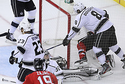 June 9, 2012; Newark, NJ, USA;  New Jersey Devils left wing Zach Parise (9) scores a goal on Los Angeles Kings goalie Jonathan Quick (32) during the first period of Game 5 of the 2012 Stanley Cup Finals at the Prudential Center.