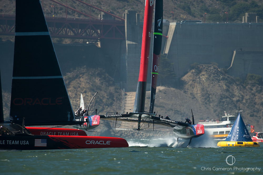 Emirates Team New Zealand and Oracle Team USA enter the start box for race 12 on day nine of America's Cup 34.. 18/9/2013