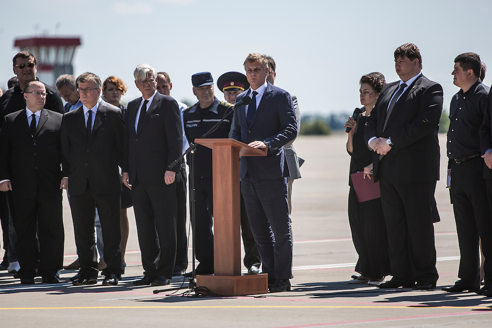 KHARKIV, UKRAINE - JULY 23: Hans Docter (C), Dutch Ambassador to Ukraine, speaks at a departure ceremony for the victims of the crash of Malaysia Airlines flight MH17 to the Netherlands during a departure ceremony on July 23, 2014 in Kharkiv, Ukraine. Malaysia Airlines flight MH17 was travelling from Amsterdam to Kuala Lumpur when it crashed killing all 298 on board including 80 children. The aircraft was allegedly shot down by a missile and investigations continue over the perpetrators of the attack. (Photo by Brendan Hoffman/Getty Images) *** Local Caption *** Hans Docter