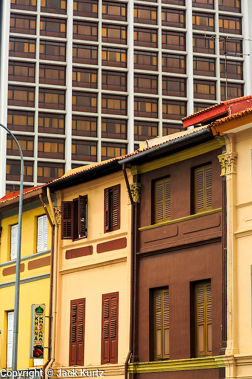 17 DECEMBER 2012 - SINGAPORE, SINGAPORE: A modern high rise building behind traditional shophouses in the Arab section of Singapore in pedicabs.      PHOTO BY JACK KURTZ