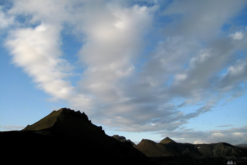 Peaks near the camp at Emstrur in southern Iceland silhouetted against a cloudy sky in the late evening in mid-summer.