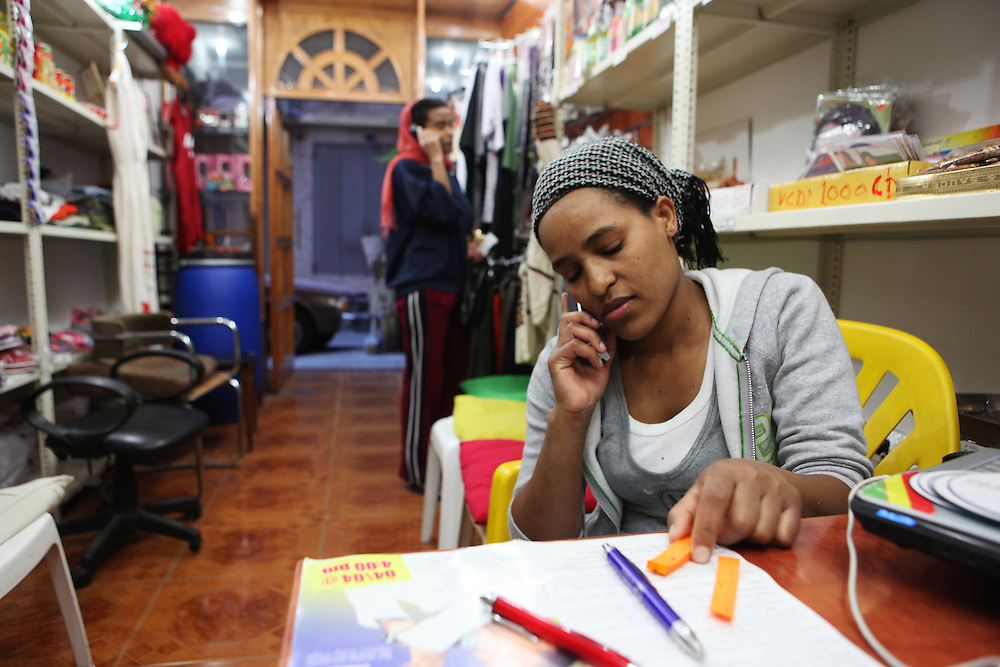 At a call center in Beirut an Ethiopian woman phones her family in Ethiopia.