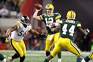 Green Bay Packers' Aaron Rodgers competes a 2-yard pass to Korey Hall in the 1st quarter. Pittsburgh Steelers' LaMarr Woodley rushes on the play. .The Green Bay Packers played the Pittsburgh Steelers in Super Bowl XLV,  Sunday February 6, 2011 in Cowboys Stadium. Steve Apps-State Journal.