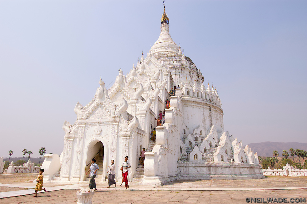 A young girl posses in front of Hsinbyume Pagoda in Mingun, Myanmar (Burma)