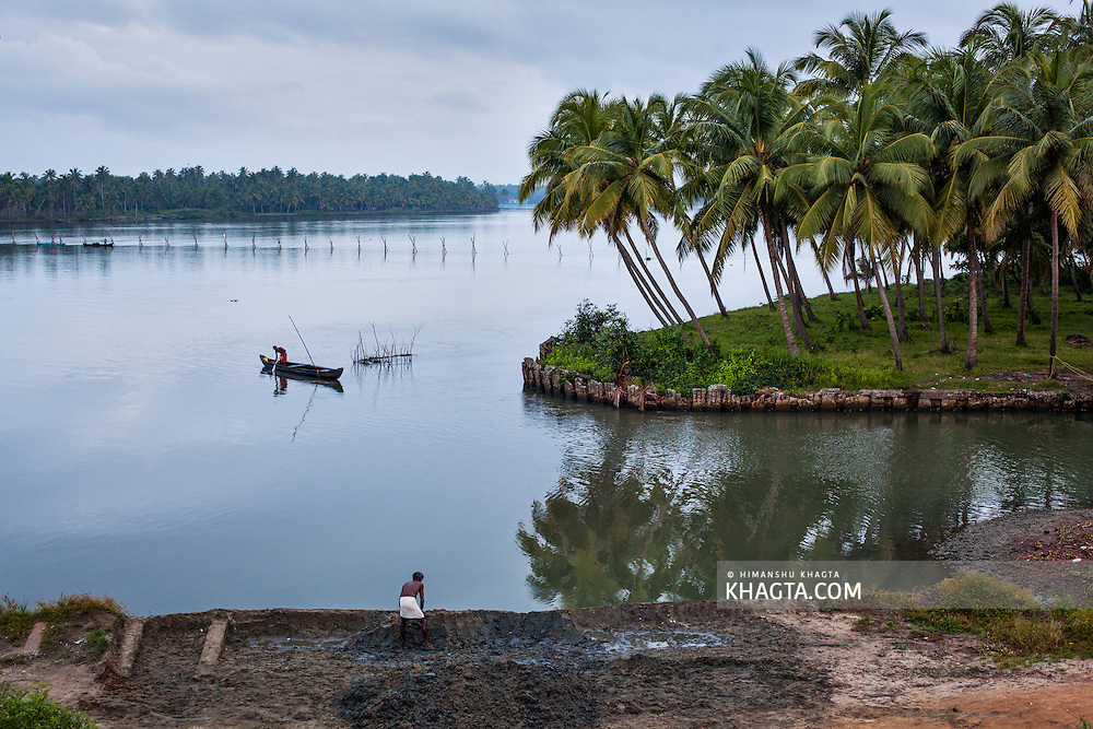 People working at the banks of Kozhikode river in Kerala, India