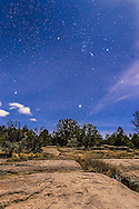 Orion and Sirius rising in the moonlight over the rocky landscape of the Gila National Forest in New Mexico north of Pinos Altos and the Continental Divide. Orion&rsquo;s three Belt stas point down to Sirius in Canis Major just rising. To the left is the other &ldquo;dog star,&rdquo; Procyon in Canis Minor.<br />