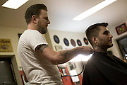 Tomcats Barber Shop.  Specalizing in Pompadour haistyles. Image © Angelos Giotopoulos/Falcon Photo Agency