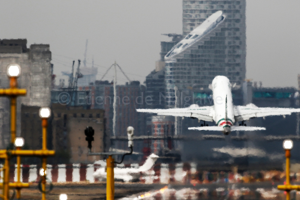 An Alitalia Embraer ERJ 190 takes off from the London City - LCY airport, 20 April 2017.