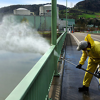 Employee cleaning the bridge leading to Beznau Nuclear Power Station situated on an articficial island in the Aar River, its two reactors /Beznau I and Beznau II) started work in 1969 and 1972. The plant is located close to the German border.<br /> The Swiss are due to vote shortly in a referendum whether to quit nuclear power, which via its five reactors, on four sites, provide almost 40% of the country's power