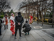 """A Chinese-speaking tourist, dressed in traditional """"furisode"""" kimono, for single women, adopts a classical pose for a snapshot at Kiyomizu Temple in Kyoto, Japan.  Donning traditional Japanese clothing is particularly popular with tourist from the Chinese mainland."""