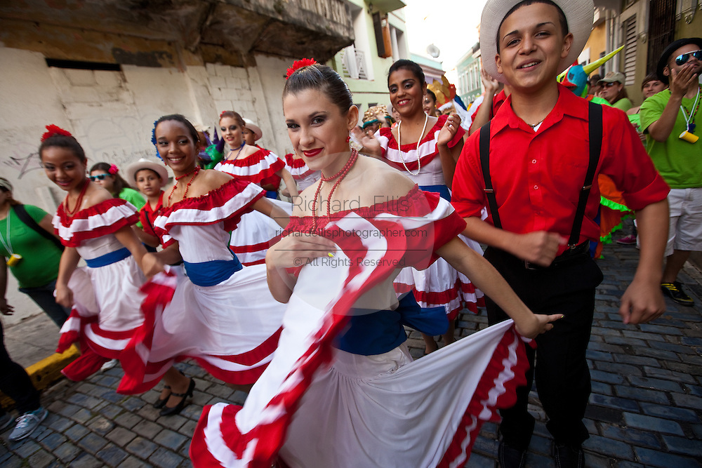 Traditional dancers parade through the streets of Old San Juan during the Festival of San Sebastian in San Juan, Puerto Rico.