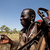 A jie warrior guards his cattle in Jonglei state, Southern Sudan.