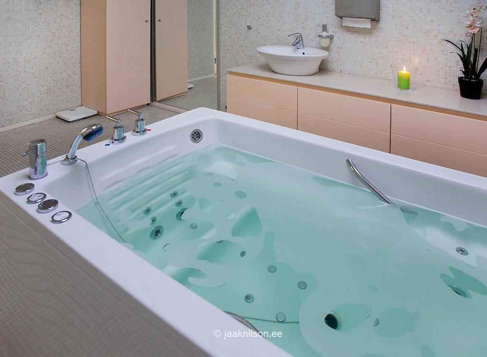 Bathroom with bath full of water in Viimsi Spa Hotel ...