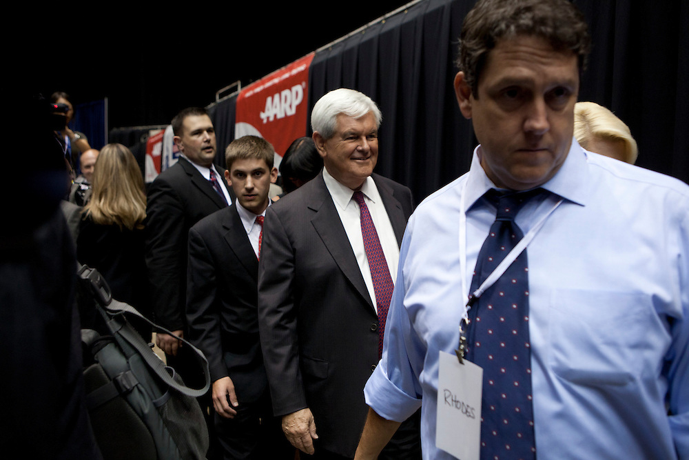 Republican presidential hopeful Newt Gingrich arrives in the media area following the Republican presidential debate on Thursday, August 11, 2011 in Ames, IA.
