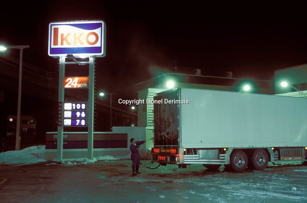 Nobuyuki the driver washes his truck somewhere in Northern Japan at 3am.