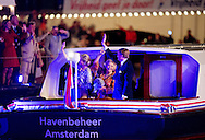 AMSTERDAM - Dutch King Willem-Alexander (R), Queen Maxima (C) and Princess Beatrix arrive to attend the annual concert marking the Liberation Day on May 5, 2013 in Amsterdam. COPYRIGHT ROBIN UTRECHT