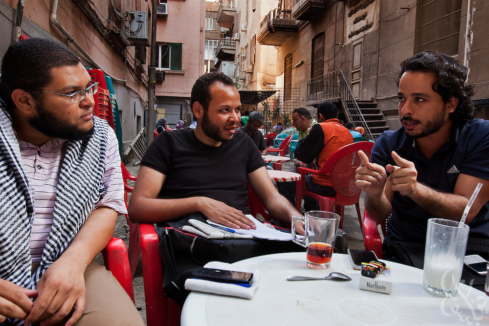 "From left: Salafi supporter Ahmed el Kordi,25, Alexandria youth activist Mohamed Abdel Salam, 23, and leader of the ""Youth for Freedom and Justice"" Khaled el Sayed, 28, discuss the upcoming presidential election at a street cafe in downtown Cairo, Egypt May 3, 2012. El Kordi and Abdel Salam support Islamist candidate Abdul Moneim Aboul Fotouh, while El Sayed does not."