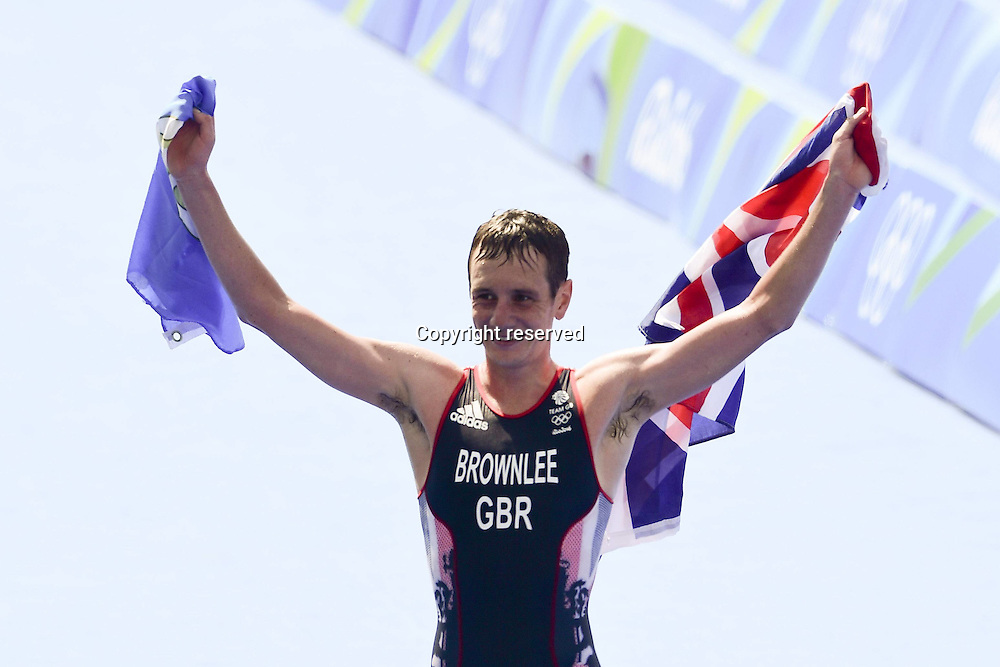 18.08.2016. Rio de Janeiro, Brazil. Alistair Brownlee of Great Britain on his way to cross the finish line to win the Men's Triathlon during the Rio 2016 Olympic Games at Fort Copacabana in Rio de Janeiro, Brazil, 18 August 2016.