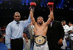 June 2, 2007; Atlantic City, NJ, USA;  Shamone Alvarez celebrates after defeating Jose Luis Cruz (black trunks) via unanimous decision in their 12 round NABO Welterweight title fight at Boardwalk Hall in Atlantic City, NJ.