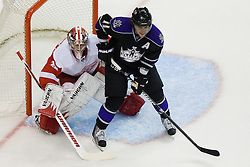 Jimmy Howard (Detroit Red Wings, #35) and Anze Kopitar (Los Angeles Kings, #11) during ice-hockey match between Los Angeles Kings and Detroit Red Wings in NHL league, February 28, 2011 at Staples Center, Los Angeles, USA. (Photo By Matic Klansek Velej / Sportida.com)