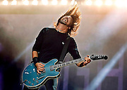 Dave Grohl of the Foo Fighters performs live on the Main stage during day 3 of Reading Festival 2012 on August 26, 2012 in Reading, England. (Photo by Simone Joyner)