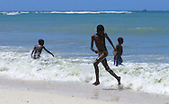DAR ES SALAAM, TANZANIA.  Young boys play in the surf at Coco Beach in Dar es Salaam, Tanzania on Sunday, September 7, 2014.  © Chet Gordon/THE IMAGE WORKS