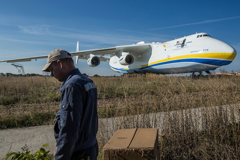 GOSTOMEL, UKRAINE - OCTOBER 1, 2014: A maintenance worker walks near the Antonov AN-225, the longest and heaviest airplane ever built, on an airfield in Gostomel, outside Kiev, Ukraine. CREDIT: Brendan Hoffman for The New York Times