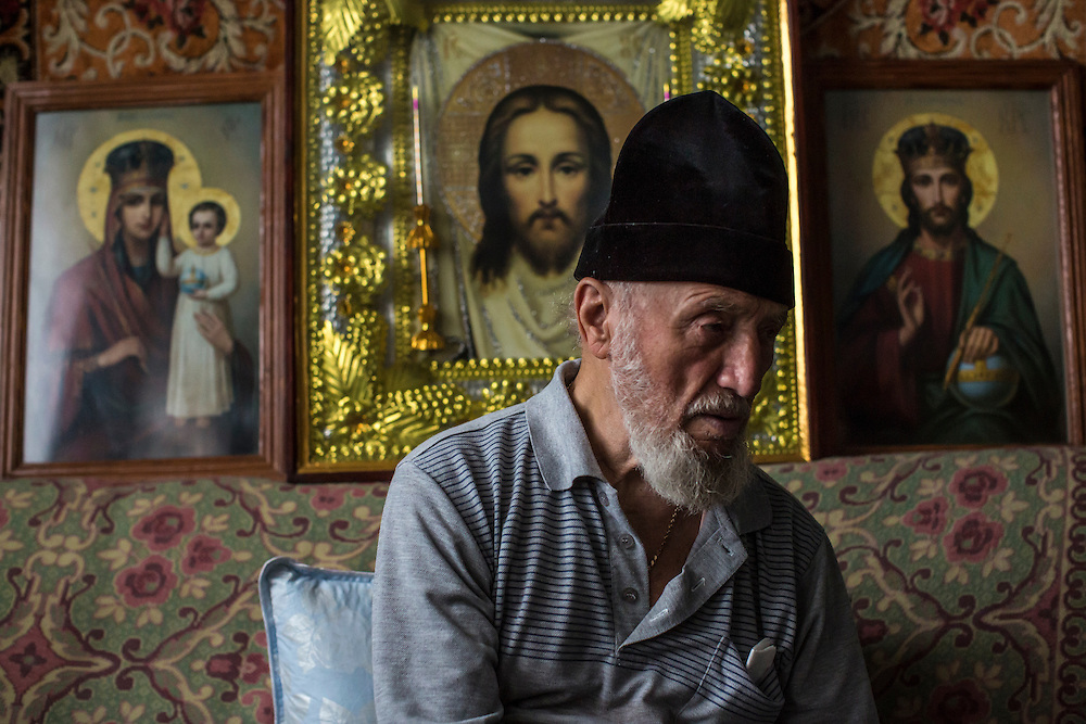 Father Dmitriy Proterey sits for an interview in his office in Saint Pokrovsky Church on Thursday, October 16, 2014 in Donetsk, Ukraine. Photo by Brendan Hoffman, Freelance