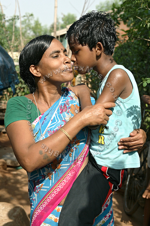 Budhia Singh, (right) 6, the famous Limca World Record marathoner, is kissing his mother near his home in Salia Sahi slum (pop. 30.000) of Bhubaneswar, the capital of Orissa State, on Sunday, May 18. On May 1, 2006, Budhia completed a record breaking 65 km run from Jagannath temple, Puri to Bhubaneswar. He was accompanied by his coach Biranchi Das and by the Central Reserve Police Force (CRPF). On 8th May 2006, a Government statement had ordered that he stopped running. The announcement came after doctors found the boy had high blood pressure and cardiological stress. As of 13th August 2007 Budhia's coach Biranchi Das was arrested by Indian police on suspicion of torture. Singh has accused his coach of beating him and withholding food. Das says Singh's family are making up charges as a result of a few petty rows. On April 13, Biranchi Das was shot dead in Bhubaneswar, in what is believed to be an event unconnected with Budhia, although the police is investigating the case and has made an arrest, a local goon named Raja Archary, which is now in police custody. **Italy and China Out**