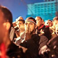 Demonstrators react to Egyptian President Hosni Mubarak's televised speech screened in Tahrir Square in Cairo, Egypt. February 2011.