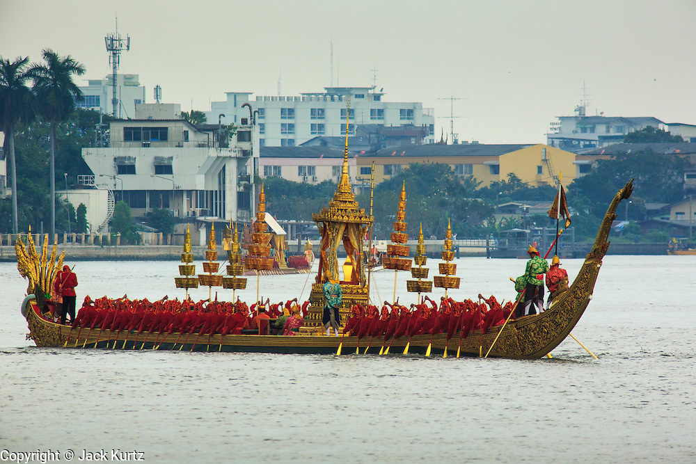 06 NOVEMBER 2012 - BANGKOK, THAILAND: The Royal Barge Anantanakkharat crewed by 54 oarsmen, heads up the Chao Phraya River to participate in the final dress rehearsal for the Royal Barge Procession in Bangkok.  Thailand's Royal Barge Procession has both religious and royal significance. The tradition is nearly 700 years old. The Royal Barge Procession takes place rarely, typically coinciding with only the most important cultural and religious events. During the reign of King Bhumibol Adulyadej, spanning over 60 years, the Procession has only occurred 16 times. The Royal Barge Procession consists of 52 barges: 51 historical Barges, and the Royal Barge, the Narai Song Suban, which King Rama IX built in 1994. It is the only Barge built during King Bhumibol's reign. These barges are manned by 2,082 oarsmen. The Procession proceeds down the Chao Phraya River, from the Wasukri Royal Landing Place in Bangkok, passes the Grand Palace complex and ends at Wat Arun. Tuesday's dress rehearsal was the final practice for the 2012 Royal Barge Procession, which takes place November 9.       PHOTO BY JACK KURTZ