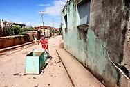 Man with hand cart in Baracoa, Guantanamo, Cuba.