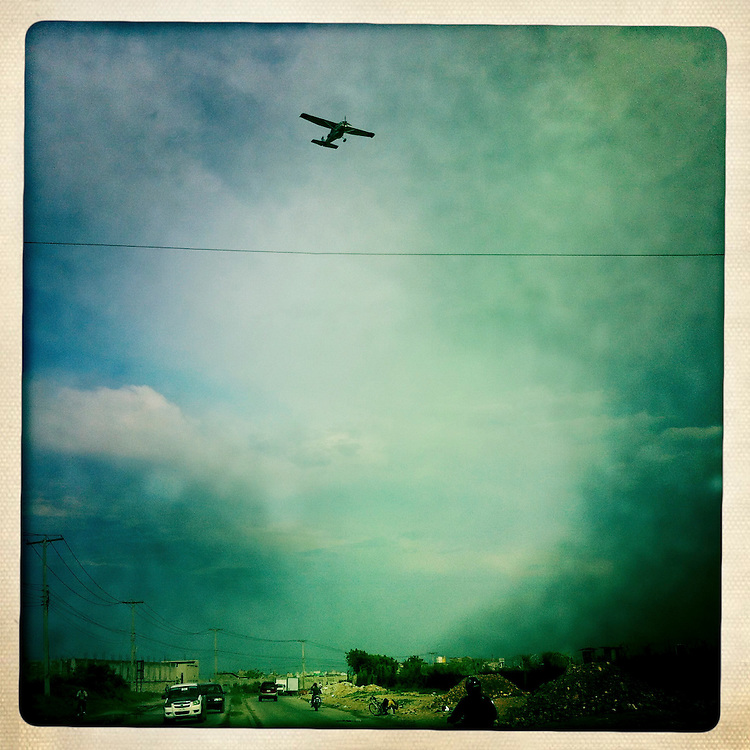 An airplane flies over downtown on Thursday, April 5, 2012 in Port-au-Prince, Haiti.