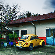 """Yellow"" by Asma Faisal.  A classic parked VW Bug--yellow as the sun, speedy like the light."